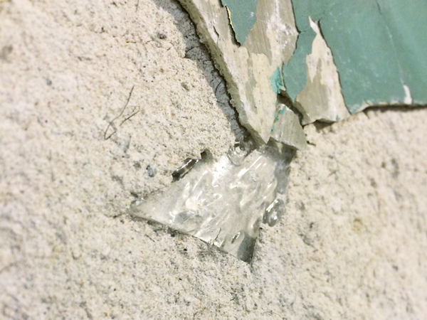 Glass Bottle in Old Plaster   Rather Square